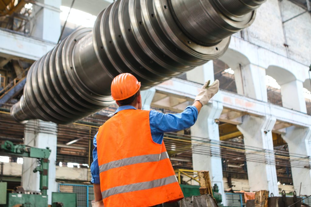 man assisting in machinery installation