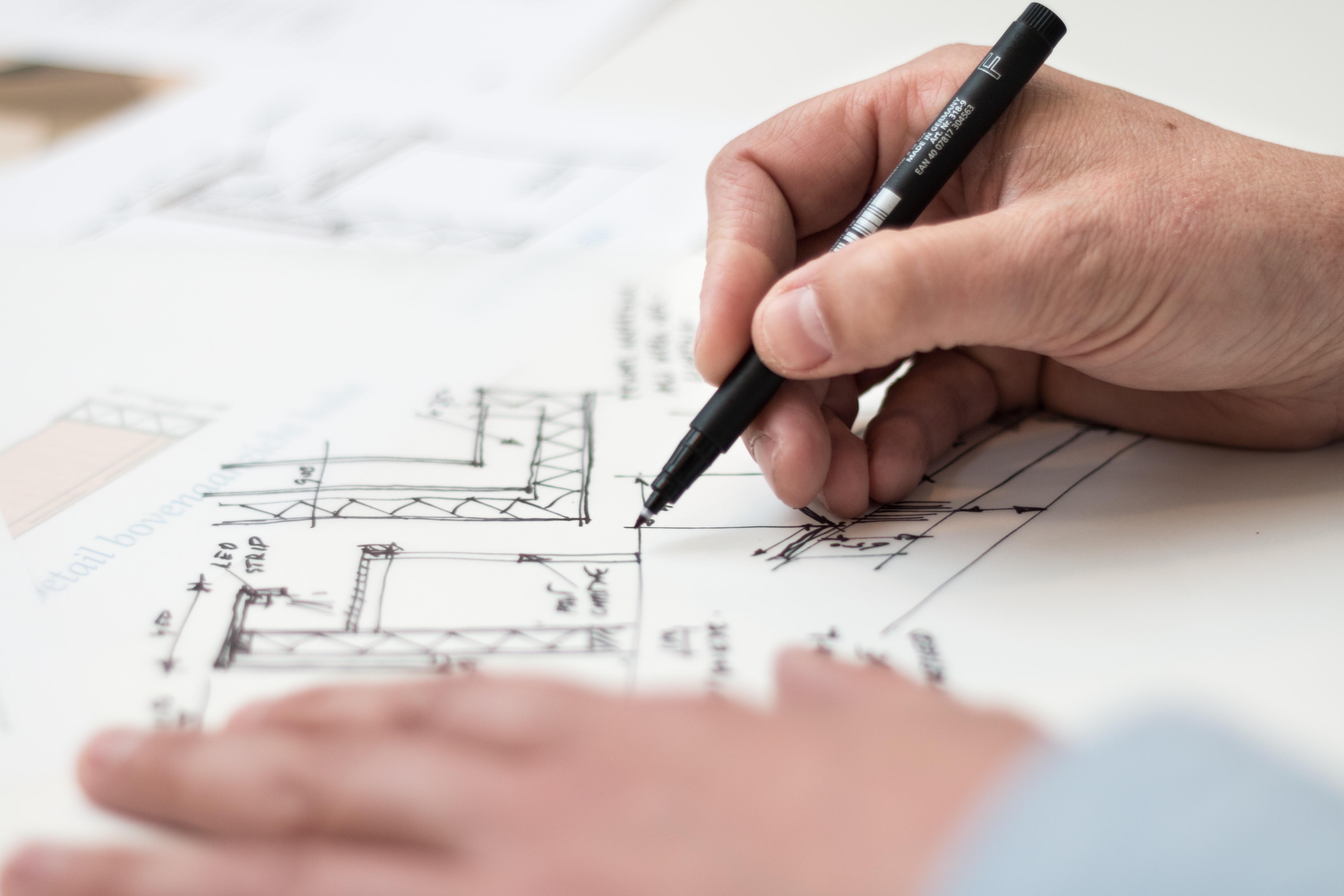 man working on blueprint