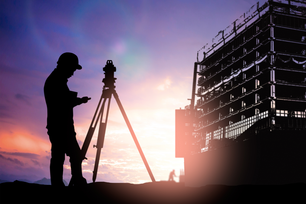 man surveying on construction site